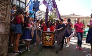 La bajada de las cuadrillas marca el arranque de las fiestas de San Roque, en Portugalete