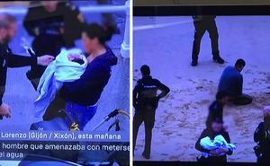 Un hombre amenaza con meterse en el agua con su bebé de dos meses en la playa de Gijón