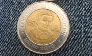 El 'gatazo': la moneda que engaña a los comerciantes