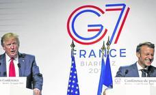 El G-7 de Macron consigue rebajar las tensiones comerciales y apaciguar a Trump